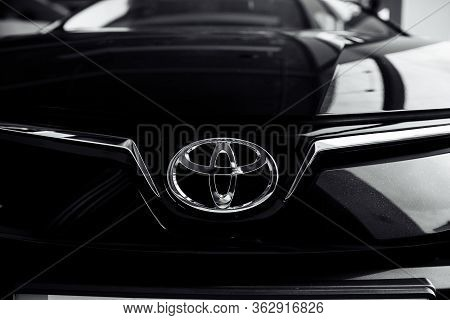 Rivne, Ukraine - October 27, 2019: Close Up Of Toyota Car Logo On A Black Toyota Car. Toyota Motor C