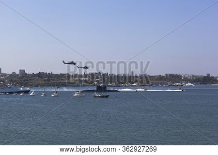 Sevastopol, Crimea, Russia - July 28, 2019: Mi-28 Attack Helicopters Fly By At The Parade In Honor O