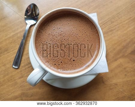 Hot Chocolate In A White Cup Top View With Its Smooth Bubble Mousse