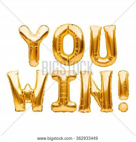 Words You Win Made Of Golden Inflatable Balloons Isolated On White. Helium Balloons Gold Foil Letter