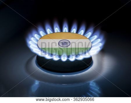 Burning Gas Burner Of A Home Stove In The Middle Of Which Is The Flag Of The Country Of India. Gas I