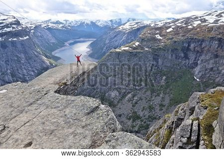 Trolltunga, Norway - July 16, 2015: Tourist Visits Awesome Troll's Tongue (trolltunga) Rock In Horda