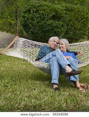 Expressive Senior Couple In Garden Hammock
