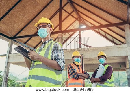 Engineer Corporate Workers Wearing Protective Masks To Prevent Dust And Covid 19 Working Together At