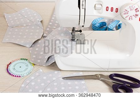 Sewing Reusable Fabric Masks At Home For Coronavirus Protection. Handmade Fabric Face Masks.