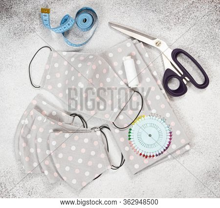 Handmade Fabric Reusable Protective Medical Masks On Gray Stone Background.