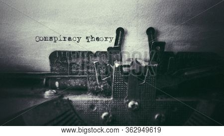 Conspiracy Theory Text Typed On Paper With Old Typewriter In Vintage Background
