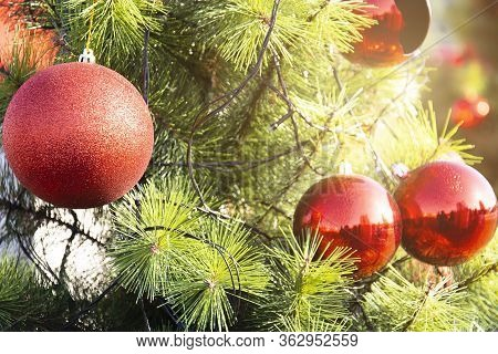 Beautiful Decorated Christmas Tree With Bright Balls, Christmas Light Background With Abstract Bokeh
