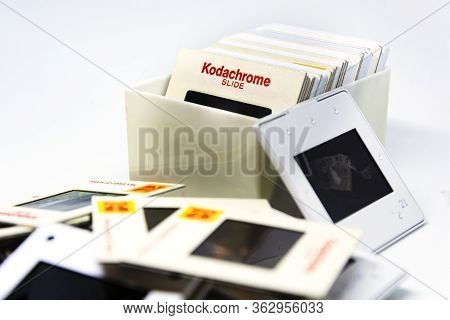 Rome, Italy, 22 April 2020: A Group Of Kodachrome Brand Slides From The 70s Inside A Plastic Box Iso