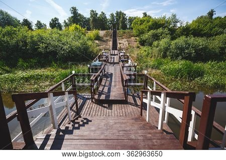 Beautiful Wooden Descent From The Landing Stage To Land. Staircase And Railing Made Of Wood Painted