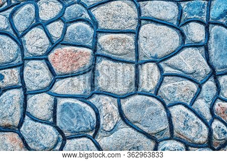 Texture Rocks Wall. Part Of A Rubble Wall, For Background Or Texture.