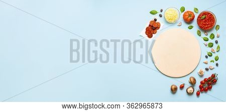 Preparing Pizza Concept With An Empty Pizza Stone And Pizza Ingredients. Top View Of Cooking Pizza W