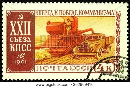 Moscow, Russia - April 22, 2020: Stamp Printed In Ussr (russia), Shows Combine Harvester And Lorry,