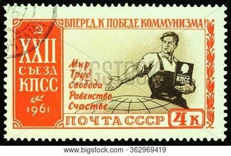 Moscow, Russia - April 21, 2020: Stamp Printed In Ussr (russia), Shows Worker With Program Of Commun