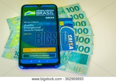April 24, 2020, Brazil. In This Photo Illustration The Auxílio Emergencial Da Caixa Application To R