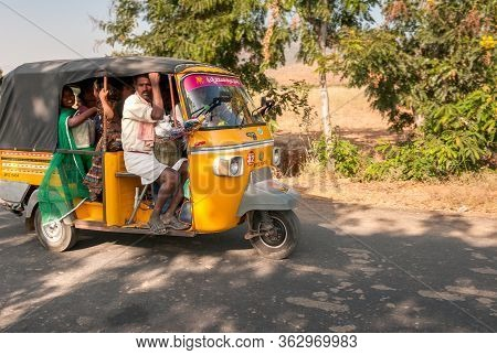 Indian People Travel In Rickshaw Taxi Along The Road Of Puttaparthi Village, India