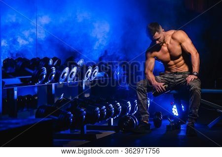 Brutal Strong Athletic Men Pumping Up Muscles. Doing Workout On Sport Equipment - Muscular Bodybuild