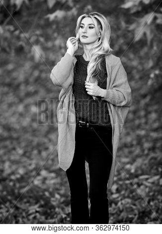 Girl Adorable Blonde Posing In Warm And Cozy Outfit Autumn Nature Background Defocused. Cozy Outfit
