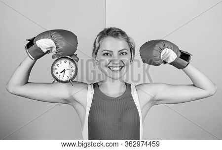Its Time For Boxing Training. Happy Woman Boxing Gloves. Girl Boxer Hold Alarm Clock. Morning Energy