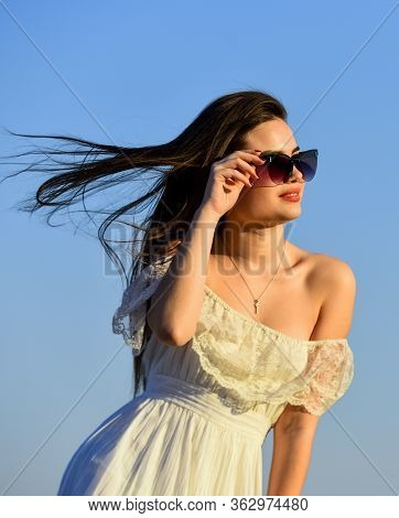 Her Perfect Style. Summer Outdoor Lifestyle. Happy Young Woman Posing Over Blue Sky. Pretty Young Be