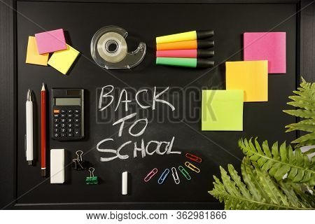 Back To School Concept On Black Flat Lay, Back To School Written With Chalk On Blackboard With Stati