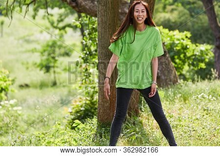 Young happy woman around green shirt as an activist and environmentalist