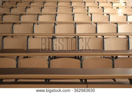 Shot Of Well Organized Empty University Classroom Seats Due To The Global Pandemic After The Cancell