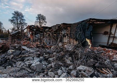 Ruins Of Old Demolished Industrial Building. Disaster Or War Consequences Concept