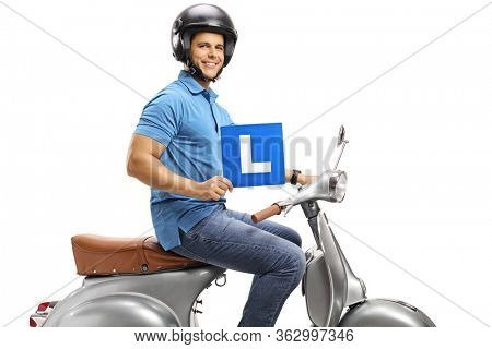 Young man on a silver vintage scooter wearing a helmet and holding a learner plate isolated on white background
