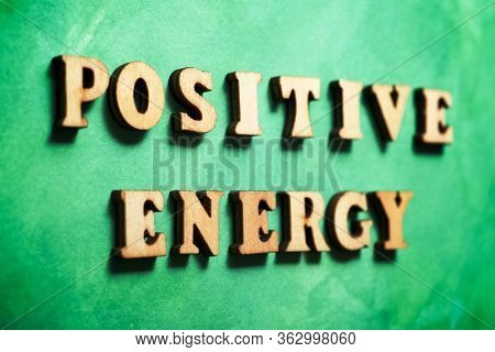Positive energy text on a colored paper.