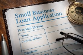 Small business loan application form on an office desk