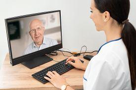 Doctor And Senior Man Patient Medical Consultation, Telehealth, Telemedicine, Remote Health Care Con