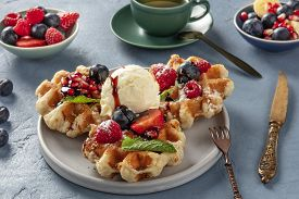 Waffles With Fresh Fruit, Chocolate, Caramel, And Ice-cream