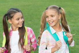 As Individual As They Are. Girls In Pigtails. Happy Girls Back To School. Beauty Look Of Little Girl