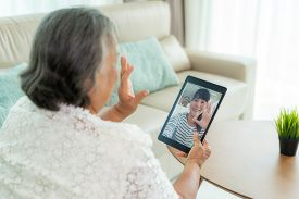 Asian Elderly Woman Virtual Happy Hour Meeting And Talking Online Together With Her Daughter In Vide