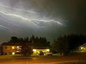 Lightning Flashes Across A Stormy Night Sky