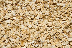 Close Up. Dry, Raw  Oatmeal  ( Oat Flakes )  Background.