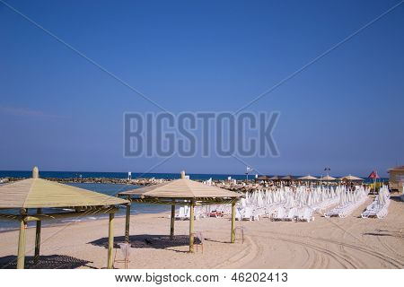 Beach Umbrellas And Sunbeds On The Sand.