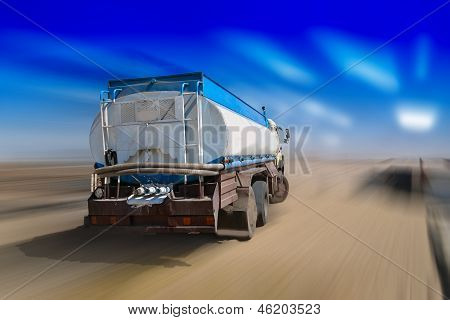 White truck speeding