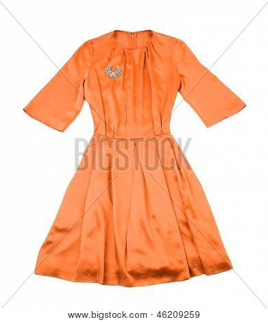 Satin tangerine evase pleated dress with diamonds brooch isolated on white background. poster