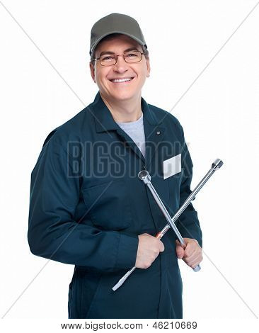 Auto mechanic with a wheel wrench. Isolated on white background.