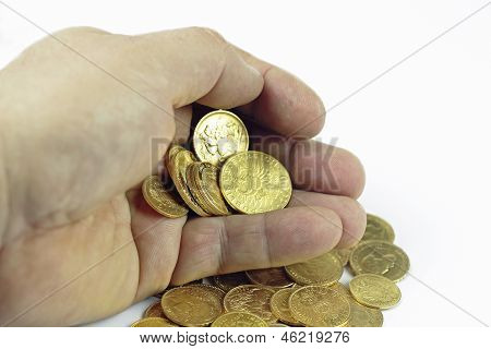 Hand with gold coins on the white background