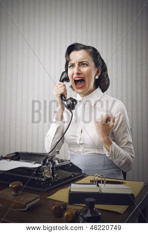 Young Business Woman Shouting Into Telephone