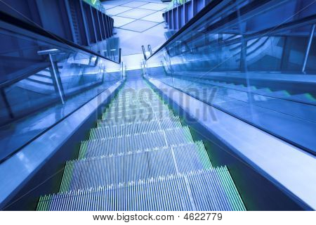Blue move escalator in modern office centre poster