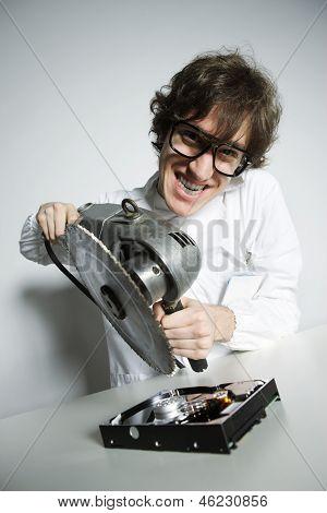 Computer technician crazy destroying a hard drive poster