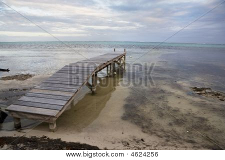 Small Wooden Pier At Sunset