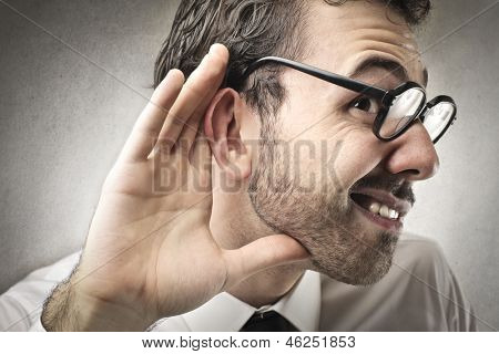 curious businessman listens