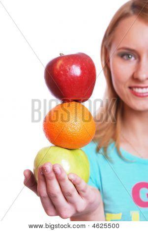 The Girl Holds Fruit