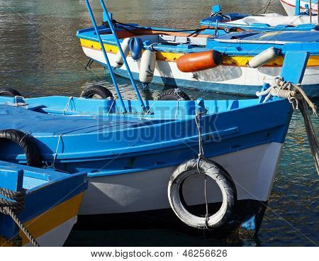 Colorful Fishing Boat Moored On Crystalline Sea