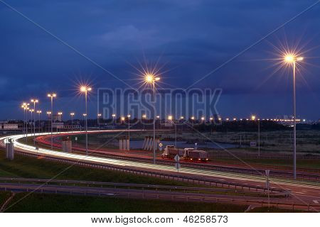 Electric Lighting On Night The Highway. Lighting Masts On Night The Track. Russian Highways.